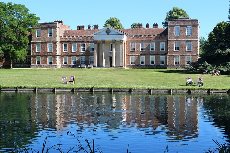 View of The Vyne, a sixteenth century Grade II listed building owned by National Trust, taken from across the lake.