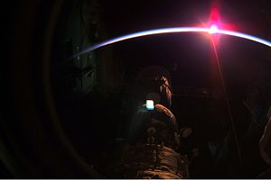 Expedition 3 - A setting sun and the thin blue airglow line at Earth's horizon photographed by an Expedition 3 crew member.