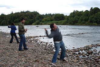 Throwing - Throwing of stones into the river