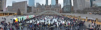 Nathan Phillips Square - Panoramic view of ice skating rink operational during Christmas Day 2018