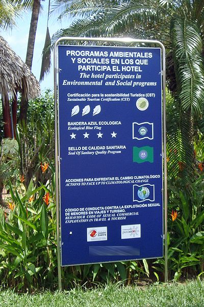 A hotel sign showing the voluntary certification programs the hotel has passed or is associated with. Shown are a four star Bandera Azul Ecologica and a three leaves CST Program. Tourism Certification Programs CRC 07 2009 6275.jpg