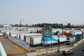 Central de Abasto - Rows of trucks parked at the market