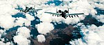 Two U.S. Air Force A-10 Thunderbolt IIs fly in a wingtip formation after refueling.jpg