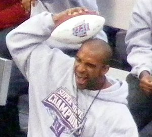 "David Tyree - Tyree reenacting the ""Helmet Catch"" during the Giants Super Bowl XLII victory rally"