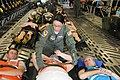 U.S. Air Force Senior Airman Milyn Kane, center, a medical technician with the 139th Aeromedical Evacuation Squadron, New York Air National Guard, secures a simulated patient for airlift in the cargo bay of 130601-Z-GJ424-042.jpg