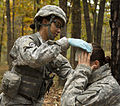 U.S. Army Capt. Vetina Willie, an Expert Field Medical Badge (EFMB) candidate with the 82nd Headquarters and Headquarters Battalion, wraps a bandage around a simulated patient's head during the EFMB competition 131104-A-KS175-006.jpg
