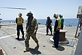 U.S. Navy Capt. Stephen Evans, the commander of Destroyer Squadron 50 arrives aboard the guided missile destroyer USS William P. Lawrence (DDG 110) to oversee maritime security pperations in support of civilian 130519-N-ZQ631-031.jpg