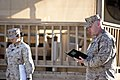 U.S. Navy Cmdr. Patrick Smith, right, a chaplain with Regional Command (Southwest), says a prayer during a flag-raising ceremony at Camp Leatherneck in Helmand province, Afghanistan, Nov. 11, 2013 131111-M-ZE445-010.jpg