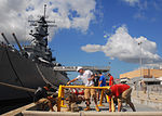 U.S. Sailors assigned to Patrol Squadron (VP) 47 paint the guard rails pierside of the Battleship Missouri Memorial on Ford Island in Pearl Harbor, Hawaii, Sept 080919-N-ER745-037.jpg