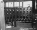 USS Oklahoma- Salvage, 2-13-43, 894-43, Front of winch control switchboard, showing controls for winches 1-8 - NARA - 296966.tif