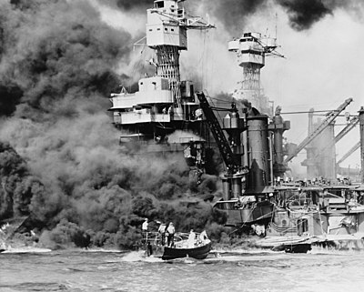 A launch rescues a seaman from the burning USS West Virginia (BB-48) after the attack on Pearl Harbor on 7 December, 1941. Smoke rolling out amidships shows where the most extensive damage occurred, the ship having sustained several torpedo and bomb hits, as well as fire damage from nearby USS Arizona. Doris Miller would famously become the first African American Navy Cross recipient for his role in the battle. Though damaged enough to settle on the bottom of the harbor, the West Virginia was repaired, refloated, and sent to fight in the Pacific Theater of World War II.