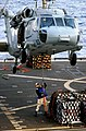 """US Navy 030206-N-5821P-009 A Sailor assigned to the combat stores ship USNS San Jose (T-AFS 7) attaches a hoist line to the bottom of an SH-60 """"Seahawk"""".jpg"""