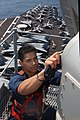 US Navy 030426-N-7781D-028 Information Systems Technician 2nd Class Ricardo Velazquez works aloft performing maintenance on one of the radars aboard USS Harry S. Truman (CVN 75).jpg