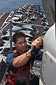US Navy 030426-N-7781D-028 Information Systems Technician 2nd Class Ricardo Velazquez works aloft performing maintenance on one of the radars aboard USS Harry S. Truman (CVN 75).jpg