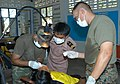 US Navy 030610-N-0493B-006 Lt. Shrikanth Ragavajan, left provides dental services to a local community member as a Royal Thai armed forces member looks on.jpg