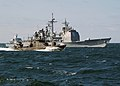 US Navy 030613-N-4374S-008 A Finish Rauma-class fast patrol boat, steams along side the Aegis class, guided missile cruiser USS Vella Gulf (CG 72) in the Baltic Sea during the annual maritime exercise Baltic Operations 2003 (BA.jpg