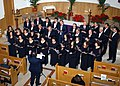US Navy 031214-N-1375K-001 A local Italian choir filled the Naples support site chapel with the sounds of a Christmas Cantata.jpg