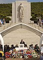 US Navy 040531-N-8157F-055 The Statue of Columbia overlooks Honolulu Mayor Jeremy Harris as he speaks to an audience of hundreds during the annual Mayor's Memorial Day Ceremony at The National Memorial Cemetery.jpg