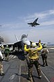 US Navy 040720-N-5781F-006 Aviation Boatswain's Mate 3rd Class Marion Roper from Grove Hill, Ala., directs an F-A-18F Super Hornet into position to be launched from the flight deck of USS Kitty Hawk (CV 63).jpg