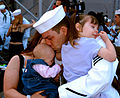 US Navy 041024-N-7397A-044 Information Systems Technician Seaman St.Clair is reunited with his family during a homecoming celebration of the amphibious assault ship USS Belleau Wood (LHA 3).jpg