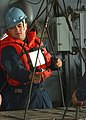 US Navy 041116-N-4561B-008 Seaman Ruben Nevarez of El Paso, Texas, attaches a sling to a pallet of ammunition being transported from USS George Washington (CVN 73) to the Military Sealift Command (MSC) fast combat supply ship U.jpg