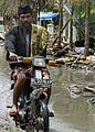 US Navy 050114-N-6817C-213 An Indonesian man rides through the devastated streets of Banda Aceh, Sumatra, destroyed by the Dec. 26 tsunami.jpg