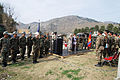 US Navy 060213-N-7024W-001 U.S. and Pakistan officials stand in respect during the Pakistan national anthem.jpg