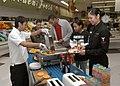 US Navy 060215-N-4649C-003 Sailors enjoy free samples of various breakfast items during the Yokosuka's commissary outreach program in Japan.jpg