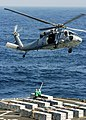 US Navy 060403-N-0499M-163 Sailors aboard the Military Sealift Command (MSC) ammunition ships USNS Shasta (T-AE 33) stand by as an MH-60S Seahawk helicopter waits to receive ammunition.jpg
