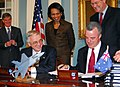 US Navy 061212-N-0962S-017 Deputy Secretary of Defense Gordon R. England and Australian Minister for Defense Brendan Nelson sign the Joint Strike Fighter (JSF) Memorandum of Understanding.jpg