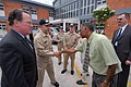 US Navy 070924-N-8704K-019 From left, David Robinson, U.S. ambassador to Guyana, and Capt. Bob Kapcio, mission commander for Military Sealift Command hospital ship USNS Comfort (T-AH 20), are greeted by Dr. Leslie Ramsammy, Guy.jpg