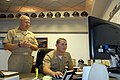 US Navy 071026-N-9909C-001 Officer Candidate Zachary Moody selects orders to USS Germantown (LSD 42) with a click of a mouse as Vice Adm. Terry Etnyre, commander of U.S. Naval Surface Forces looks on.jpg