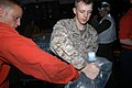 US Navy 071129-N-5642P-026 Sailors and Marines aboard the amphibious assault ship USS Kearsarge (LHD 3) pass bags of drinking water for distribution to the victims of Tropical Cyclone Sidr in Bangladesh.jpg