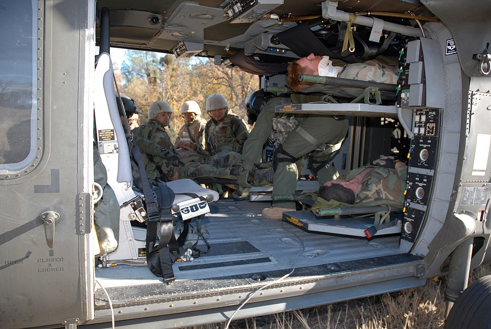 US Navy 071211-N-9623R-006 Seabees from Naval Mobile Construction Battalion (NMCB) 17 assist in loading fellow Seabees into a Blackhawk medical evacuation helicopter (MEDAVAC) during a mass casualty drill