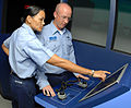 US Navy 080826-N-0995C-021 Personnel Specialist 1st Class Christina Matthews gives a pass-down to one of her fellow chief petty officer (CPO) selects on manning the navigation radar when on the bridge.jpg