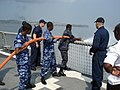 US Navy 090114-N-8270S-002 Sailors assigned to the guided-missile frigate USS Robert G. Bradley (FFG 49) teach firefighting techniques to Sailors from the Equatorial Guinean Navy.jpg