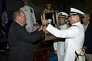 US Navy 090925-N-0683T-170 Retired Rear Adm. Dick Lyon, the first Bullfrog, left, passes the Bullfrog trophy to Capt. Pete Wikul, the 13th Bullfrog, during the passing of the Bullfrog ceremony