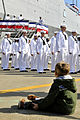 US Navy 090930-N-3595W-317 The grandson of Vice Adm. Frank Donovan watches as the decommissioning crew of the amphibious transport dock ship USS Nashville (LPD 13) departs the ship for the final time.jpg