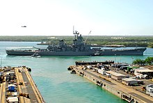 The battleship Missouri (BB-63) begins its 2-mile journey back to Ford Island after being undocked by hundreds of Pearl Harbor Naval Shipyard workers in 2010.