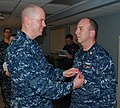 US Navy 100224-N-3090M-123 Cmdr. Charles Maher, commanding officer of the fast attack submarine USS Memphis (SSN 691), pins a Bronze Star medal on the uniform of Chief Electronics Technician William Cox Jr.jpg