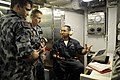 US Navy 100506-N-8959T-202 Gas Turbine Systems Technician 2nd Class Jose Ramos explains the ship's machinery consoles to Australian Navy Able Seamen.jpg