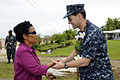 US Navy 100727-N-4031K-449 Vice Adm. John Bird shakes hands with Romana Anastacio at Ngchesar Elementary School in Koror, Palau.jpg