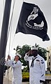 US Navy 100804-N-3666S-015 Culinary Specialist 1st Class Richard Cravens, left, and Operations Specialist 2nd Class James Darde raise the POW-MIA flag during morning colors.jpg