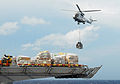 US Navy 101021-N-2218S-195 An AS332 Super Puma helicopter moves pallets of supplies to the amphibious assault ship USS Essex (LHD 2).jpg