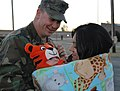 US Navy 101210-N-7084M-168 A Seabee assigned to Naval Mobile Construction Battalion (NMCB) 7 is greeted by his family during a homecoming ceremony.jpg