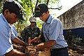 US Navy 110223-N-WX845-085 Equipment Operator 2nd Class Danny Shannon, assigned to Naval Mobile Construction Battalion (NMCB) 28, helps Salvadoran.jpg
