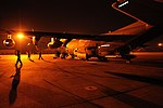 US Navy 110312-M-2739S-002 Marines and Sailors disembark from a KC-130 Hercules during a humanitarian assistance mission in response to the earthqu.jpg