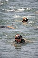 US Navy 110405-N-KK330-156 A Basic Crewman Training (BCT) candidate takes a breath during a conditioning swim in San Diego Bay.jpg