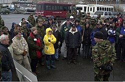 US Navy Petty Officer Second Class Chris Roath of the Explosive Ordinance Mobile Unit 3, Detachment 6 Marine Mammal Systems briefs Lieutenant General Norty Schwartz, Commander of Alaskan Command and Alaskan 010321-F-LX971-011.jpg