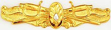 US Navy Surface Warfare - Medical Corps insignia.jpg